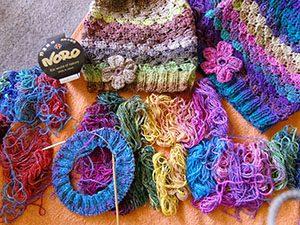 Wolle Noro Silk Garden Sock Farbe 87 mit Mützen aus Noro Silk Garden Sock 387 und 308