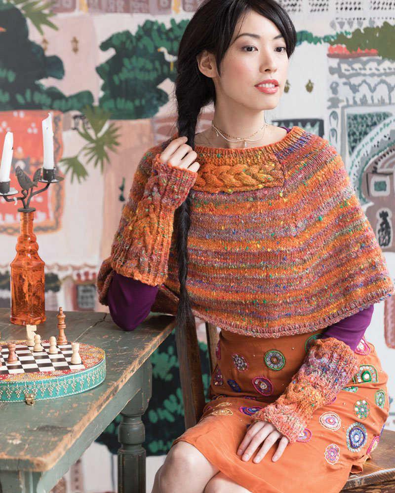 Poncho und Armstulpen in der Farbe Orangeville mit eben viel Orange
