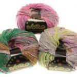3 Knäule Norowolle in Pastelltönen mit aus Rosa, Grün, Hellgelb, Flieder, Hellbraun und Weiß.