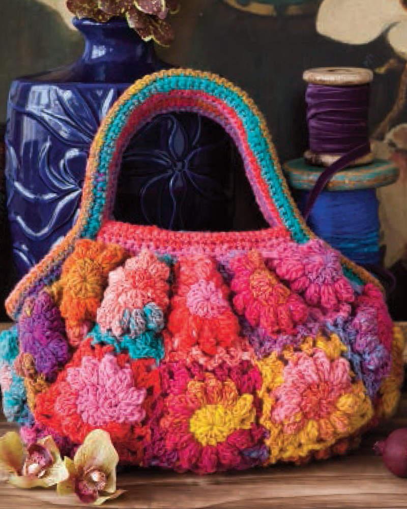 Gehäkelte Tasche aus Granny Squares aus der knallbunten Noro Kureyon #256 mit Rot, Pink, Gelb, Türkis und Violett-Tönen. - Noromaniac