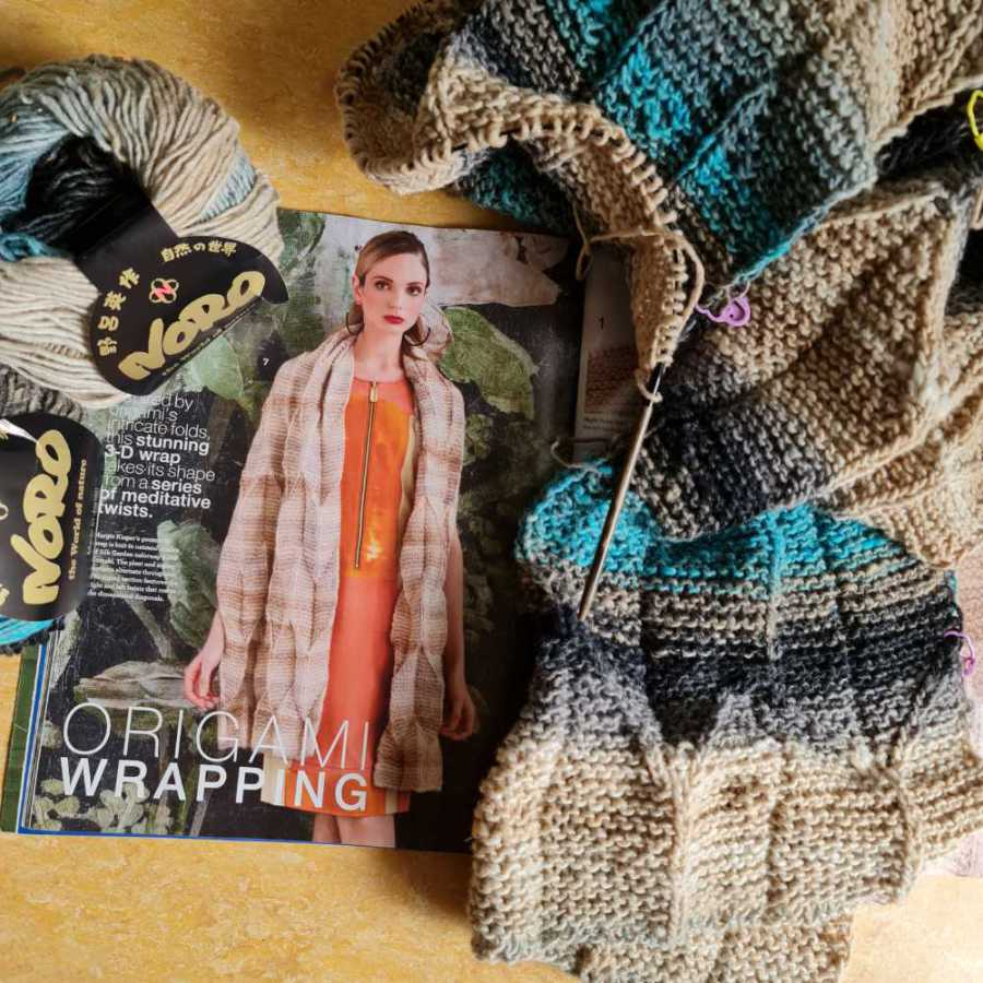 The Origami Shawl design from Noro Knitting Magazine 14 along with the yarn Noro Shiro Color #2, from which Noromaniac, knitted her stole in beige, gray, black and turquoise. Photo: Katrin Walter