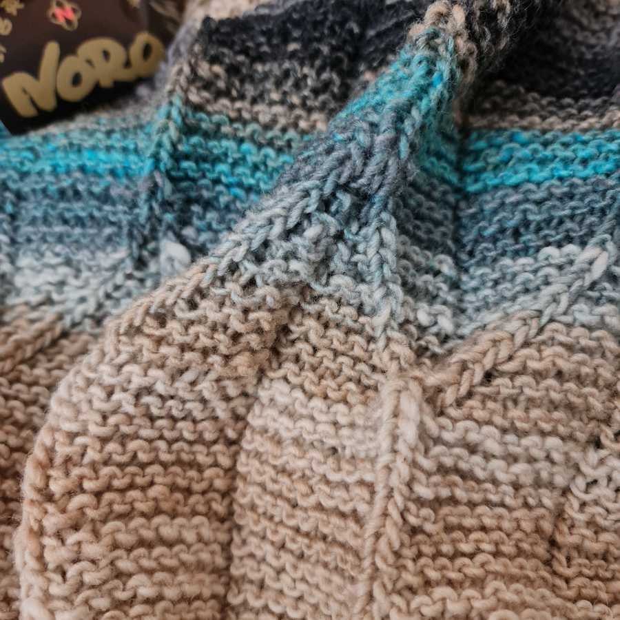 The Origami Shawl design up close, you can see here hut the knitted folds. Photo: Katrin Walter - Noromaniac