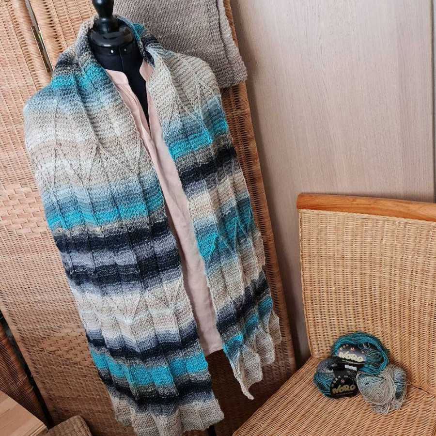 The Noro Shiro knitted in the wide stole, called Origami Shawl design and three skeins of this Noro yarn. Photo Katrin Walter - Noromaniac